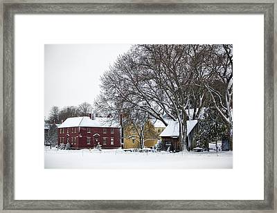 Snowy Village Framed Print by Eric Gendron