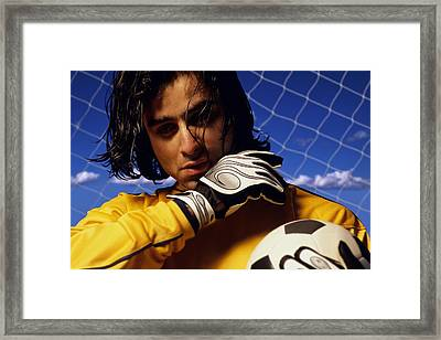 Soccer Goalkeeper In Net Framed Print by Don Hammond