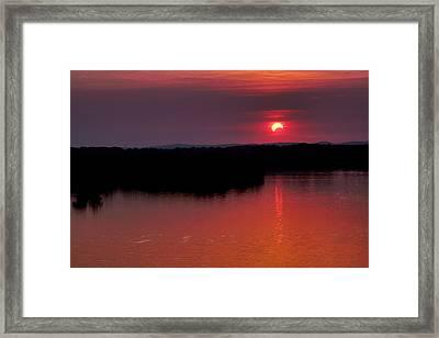 Solar Eclipse Sunset Framed Print by Jason Politte