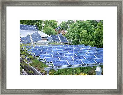 Solar Panels On Green Roof Framed Print by Louise Murray