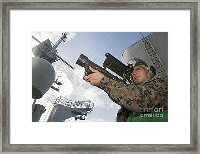 Soldier Practices Tracking Framed Print by Stocktrek Images