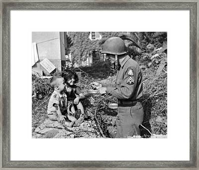 Soldier Shares His Meal Framed Print by Underwood Archives