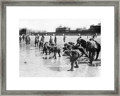 Soldiers Collecting Seashells Framed Print by Underwood Archives