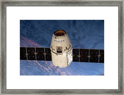Spacex Dragon Capsule At The Iss Framed Print by Nasa