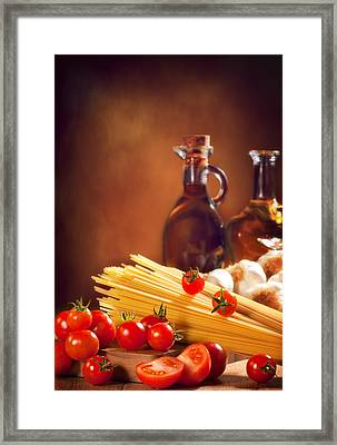 Spaghetti Pasta With Tomatoes And Garlic Framed Print by Amanda And Christopher Elwell