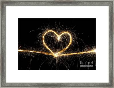 Spark Of Love Framed Print by Tim Gainey