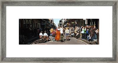 Spectator Looking At Street Musician Framed Print by Panoramic Images