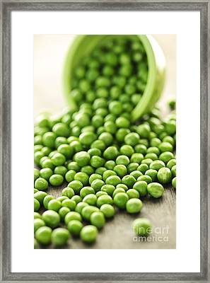 Spilled Bowl Of Green Peas Framed Print by Elena Elisseeva
