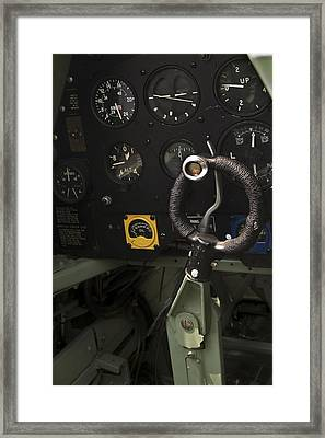 Spitfire Cockpit Framed Print by Adam Romanowicz
