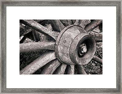 Spokes And Axle Framed Print by Olivier Le Queinec
