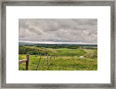 Spring Storm Over The Foothills Framed Print by Heather Simonds
