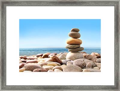 Stack Of Pebble Stones On White Framed Print by Sandra Cunningham