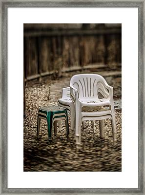 Stacked Plastic Chairs Framed Print by YoPedro