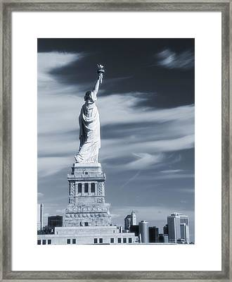 Statue Of Liberty Facing New York City Framed Print by Dan Sproul