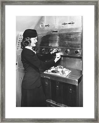Stewardess Preparing Dinner Framed Print by Underwood Archives