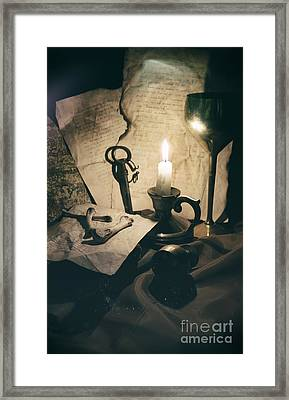 Still Life With Bones Rusty Key Wine Glass Lit Candle And Papers Framed Print by Jaroslaw Blaminsky
