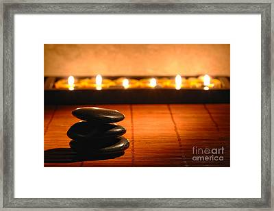 Stone Cairn And Candles For Quiet Meditation Framed Print by Olivier Le Queinec