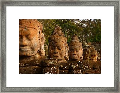 Stone Heads Framed Print by FireFlux Studios