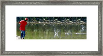 Stone Skipping In Calm Water Framed Print by Roy Williams