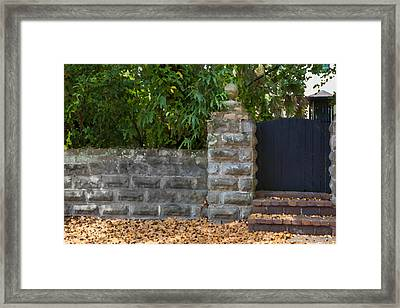 Stone Wall And Gate Framed Print by Rich Franco