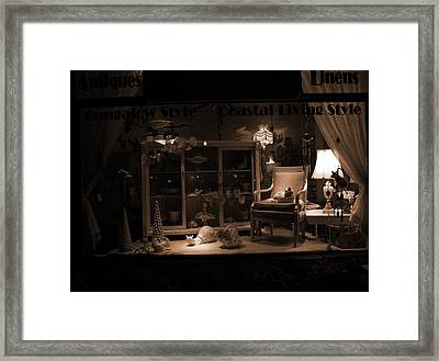 Store Window At Night Framed Print by Phil Penne
