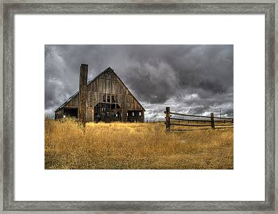 Storm Over Abandoned Barn Framed Print by Jean Noren