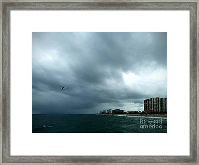 Storm Over Pompano Framed Print by Sally Simon