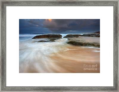 Storm Surge Sunrise Framed Print by Mike Dawson