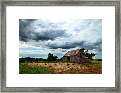 Storms Loom Over Barn On The Prairie Framed Print by Toni Hopper