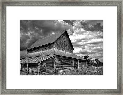 Stormy Clouds Over The Rustic Old Barn Framed Print by Reid Callaway