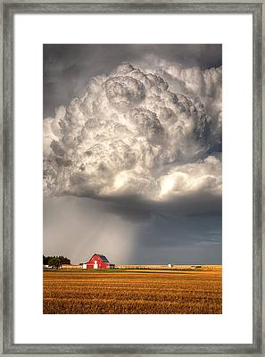 Stormy Homestead Barn Framed Print by Thomas Zimmerman