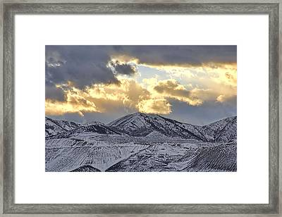 Stormy Sunset Over Snow Capped Mountains Framed Print by Tracie Kaska