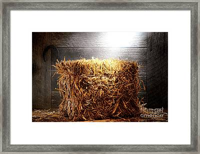 Straw Bale In Old Barn Framed Print by Olivier Le Queinec