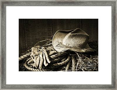 Straw Hat With Gloves On A Bale Of Hay Framed Print by Sandra Cunningham