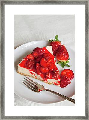 Strawberry Topped Cheesecake On A Round Framed Print by Brian Jannsen