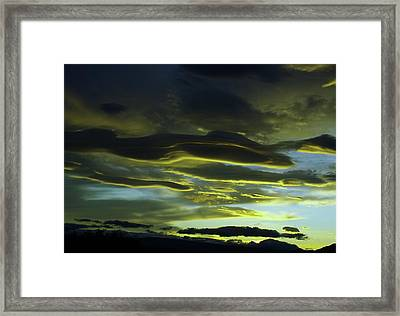 Streaming Clouds  Framed Print by Jeff Swan