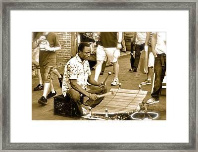 Street Musician Framed Print by Kristina Deane