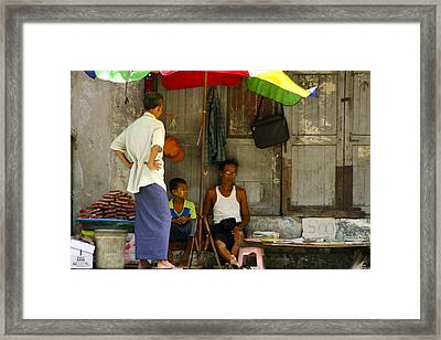 Street Seller Sitting In The Shade Under An Umbrella Yangon Myanmar Framed Print by Ralph A  Ledergerber-Photography