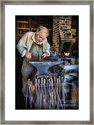 Striking The Anvil - Blacksmith Framed Print by Lee Dos Santos