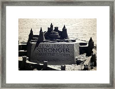 Stronger Than The Storm Framed Print by John Rizzuto