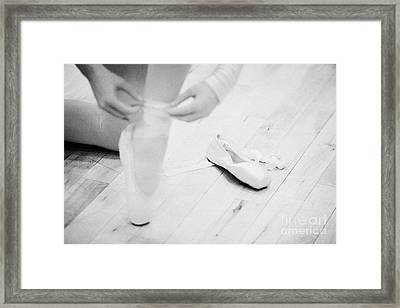 Student Putting On Pointe Shoes At A Ballet School In The Uk Framed Print by Joe Fox
