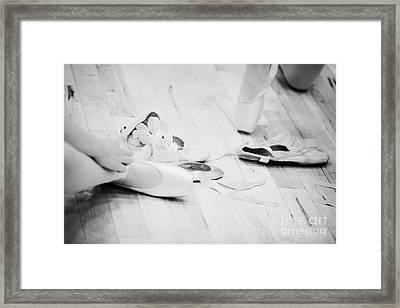 Students Putting On Pointe Shoes At A Ballet School In The Uk Framed Print by Joe Fox