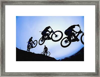 Stunt Cyclists, Alberta, Canada Framed Print by Corey Hochachka