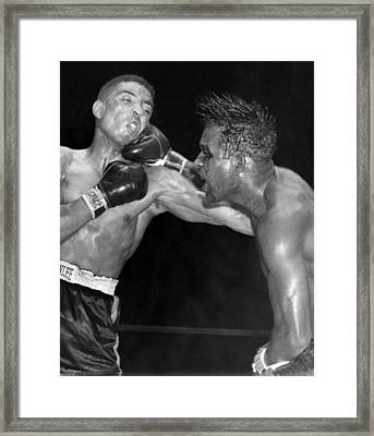 Sugar Ray Throws A  Right Framed Print by Underwood Archives