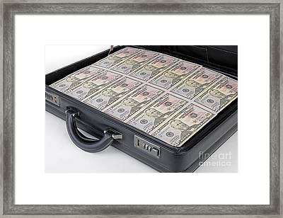 Suitcase Full Of Money Framed Print by Ingo Schulz