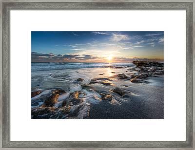 Sun Rays On The Ocean Framed Print by Debra and Dave Vanderlaan