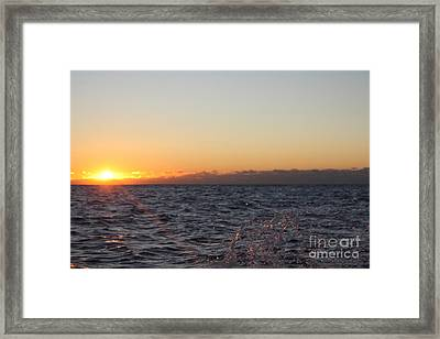 Sun Rising Through Clouds In Rough Waters Framed Print by John Telfer