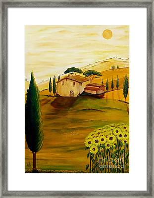 Sunflowers In Tuscany Framed Print by Christine Huwer