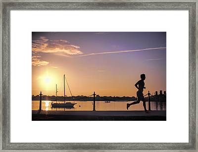 Sunrise Bayfront Runner Framed Print by Stacey Sather