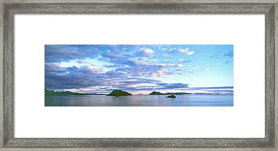 Sunrise Clouds Reflect In The Still Framed Print by Panoramic Images